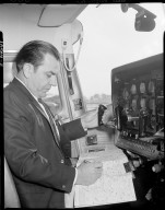 Bigsby Accessories, Inc., pilot in plane cockpit looking at map in front of instrument panel