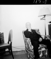 Man seated in armchair in living room