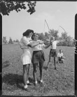 Young girls learning archery