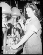 Woman working a drill press