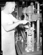 Man working a drill press