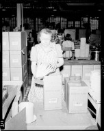Sutherland Paper Company, worker packing paper plates