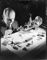 Paul E. Morrison Jewelers, watchmaker with tools