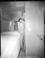 Kozy Coach Company, trailer interior, woman in bedroom