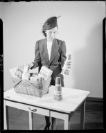 Sutherland Paper Company, woman with basket of groceries including Kellogg's All-Bran and Sierra Oaks Dairy milk