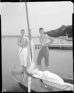 Kalamazoo Pant Company, teenage boys modeling pants standing on sailboat in Gull Lake