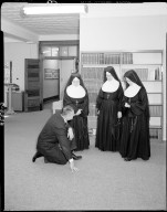 Barbour Hall Junior Military Academy, interior, nun and man examining new carpeting