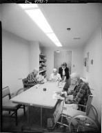 Harold & Grace Upjohn Community Nursing Home, raft instructor and residents making handicrafts and sanding wood cutouts