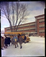 Western Michigan College, students at shuttle bus in front of Seibert Administration Building