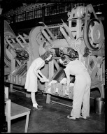 Sutherland Paper Company, workers at paper plate machine