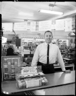 Hoekstra Sales Company, interior, Jim Ippel behind counter