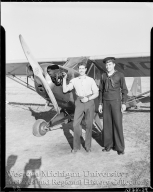 Western Michigan Flying Service, portrait of Nick Raphael and man in naval uniform with an airplane