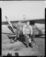 Western Michigan Flying Service, pilot leaning against airplane