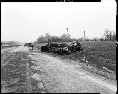 Overturned semi-truck on highway