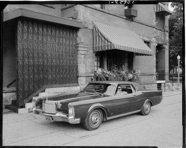 Man in a 1969 Lincoln Continental Mark III outside of the Park Club