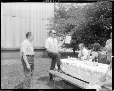 Meed Container Corporation, Garth Miller presenting award to Frank Hiestand at company picnic