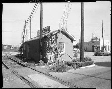 Triangle Service Station train damage, Kalamazoo Avenue at Water Street