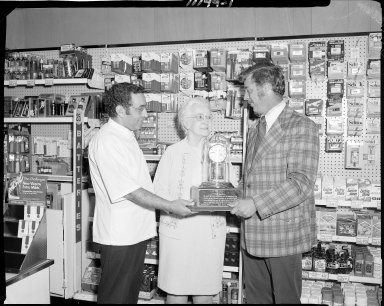 Revco Drug Store, woman receiving clock as millionth customer