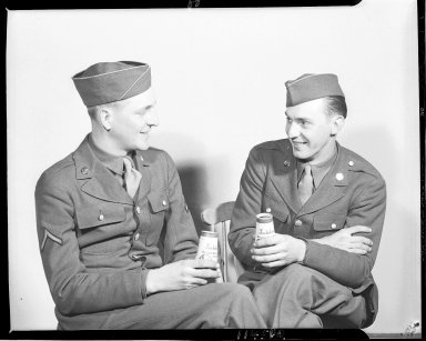 Sutherland Paper Company, two Army enlisted men drinking from 1/2-pint milk containers