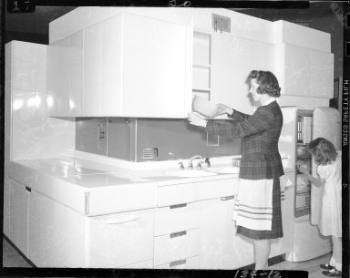 Domestic interior, kitchen design demonstrating cupboards and refrigerator