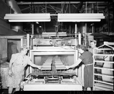 Kalamazoo Stove Company, two women and a man in production area