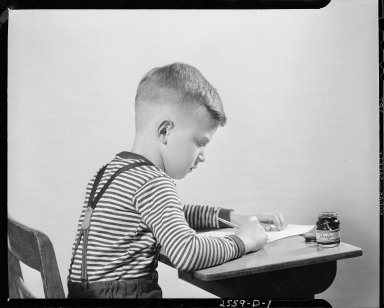 Sutherland Paper Company, school boy writing at desk