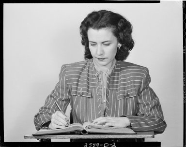 Sutherland Paper Company, woman doing bookkeeping