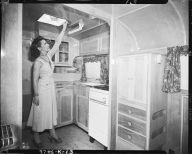 Kozy Coach Company, trailer interior, woman in kitchen
