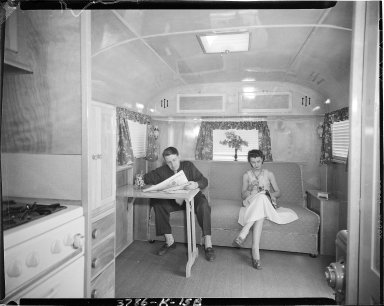 Kozy Coach Company, trailer interior, man and women on couch