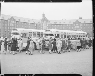 Women boarding buses