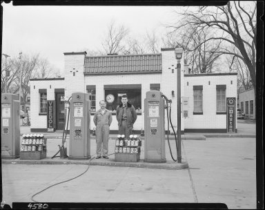 Neil and Marv's Phillips 66 Service Station, attendants at pumps, Kalamazoo, MI