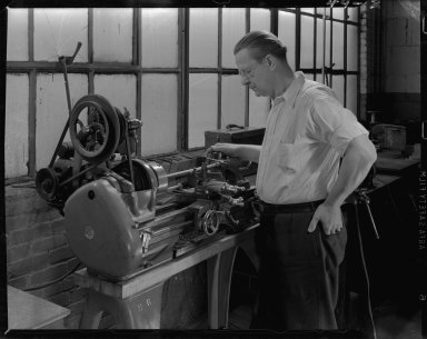 Atlas Press Company, employee of Humphrey Company operating a lathe