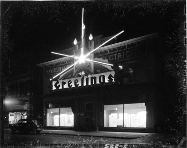 Consumers' Power Company, exterior, with holiday decorations at night