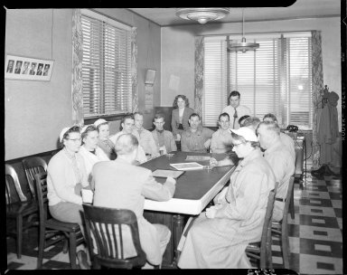 Peter Eckrich & Sons, Inc., employees meeting at a table