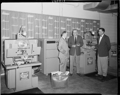 Hammond Machinery Builders, Inc., industrial grinding machine display with sales representatives