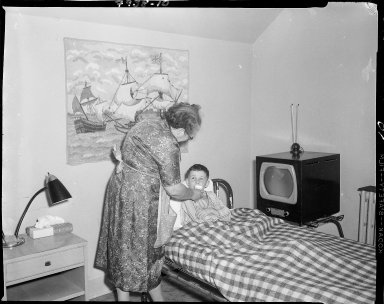 Lake Farm Boys Home, Kalamazoo, interior, women tending sick boy in bed