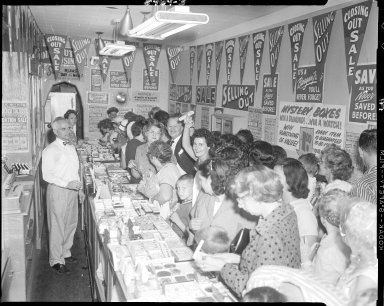 Corson's Jewelry store, interior, with customers for selling out sale