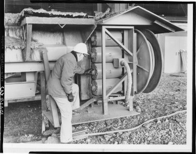 Aero-Motive Manufacturing Company, workman examining steel mill reel components