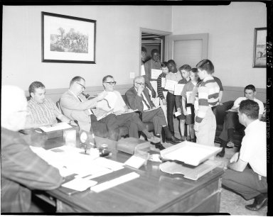 Kalamazoo Pant Company, teenage and school age boys modeling pants in conference room