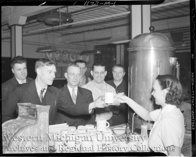 Kalamazoo Stove Company, woman selling coffee to group of men