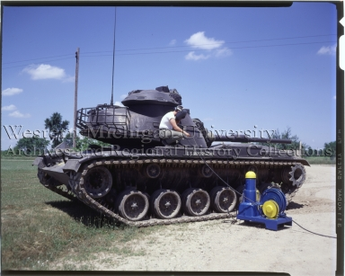 Worker welding a M60A1 tank at Fort Custer