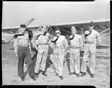 Western Michigan Flying Service, group portrait of five cadets with airplane