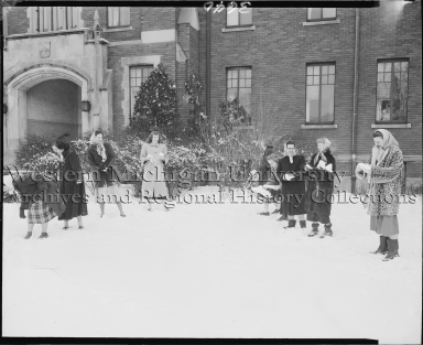 Women having a snowball fight outside of Borgess Hospital