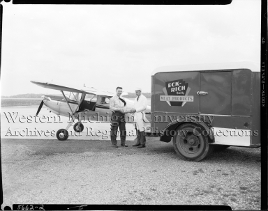 Peter Eckrich and Sons Inc., delivery driver handing package to pilot
