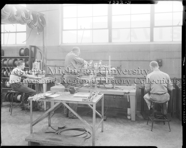 Klose Electric Company, men working on shop floor