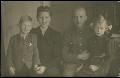Picture postcard of German soldier and his family