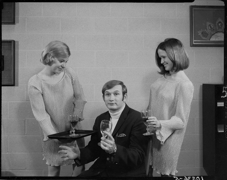 Don Neal's Mr. T-Bone, man and two women posing with goblets, nightclub promotion