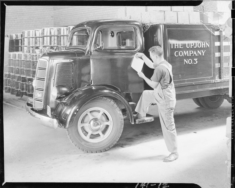 Upjohn Company delivery truck and driver