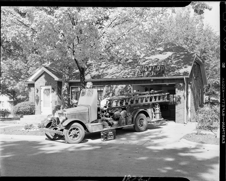 Milwood Fire Department, exterior, with fire truck