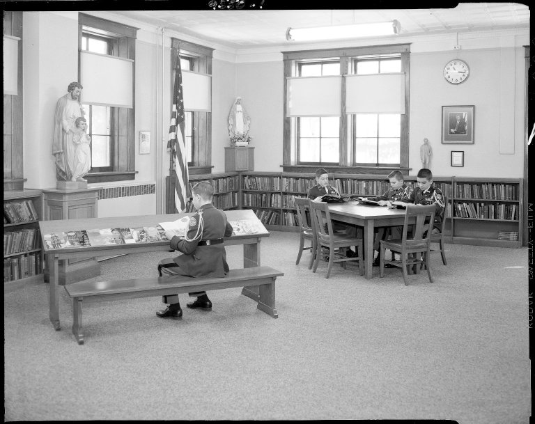 Barbour Hall Junior Military Academy, interior, with boys studying at tables in library